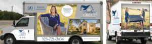 Image of the side of a step van with a large picture of Kristi Andrew